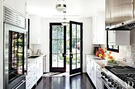 a kitchen white kitchens pictures a dramatic black door and windowpanes draw