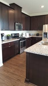 what color wood floors go with espresso cabinets vinyl flooring with cabinets vinyl flooring