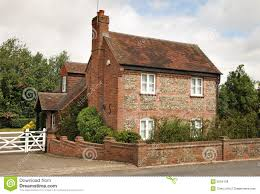 traditional brick and flint english cottage royalty free stock