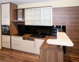 kitchen style u shape textured wood kithen cabinet and black