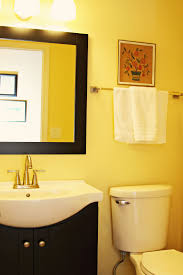 interior nice bathroom decoration with yellow and white wall plus