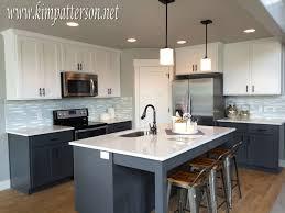 white upper black lower kitchen cabinets bar cabinet