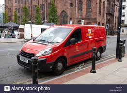 peugot uk royal mail peugeot delivery van on double yellow lines manchester