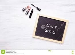 paper with writing on it chalkboard with beauty school written on it and cosmetic produc background
