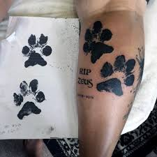 picture of dog paw tattoo on the leg