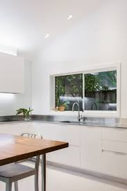 Small Kitchen With Reflective Surfaces Small Contemporary Kitchen Makes Room For Home Office And Laundry