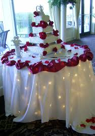 elegant wedding cake table decoration matched with lovely red