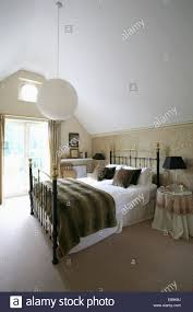 Cream And White Bedroom Wallpaper Faux Fur Throw And White Linen On Antique Brass Bed In Bedroom