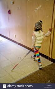 White Cane Blind Using A White Cane And Feeling The Wall With Her Hand A Blind