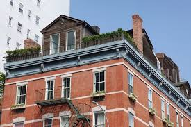 Building A House On A Slope See Inside The Mysterious Cottage Atop An East Village Building