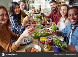 friends at thanksgiving dinner stock photo pressmaster 130582744