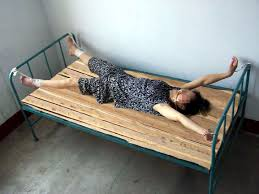 handcuffed to bed ms yan zongfang from sichuan province dies as a result of