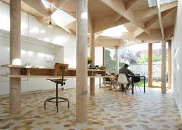 timber fins pattern the ceiling of ghent extension by atelier vens