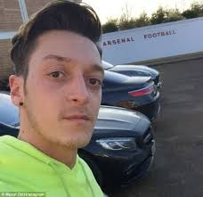 mesut ozil hair style mesut ozil says i m back as arsenal star returns to the club s