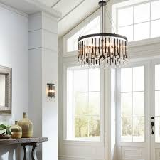 decor front entry door with window treatments and foyer lighting