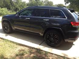 jeep cherokee white with black rims any purists who were worried that the 2014 jeep grand cherokee was