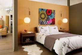 chic modern bedroom table lamps with partial wall fur rug