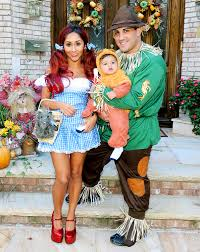 jersey shore star snooki and her fiance in a wizard of oz ensemble