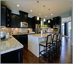 dark kitchen cabinets with glass backsplash light countertops