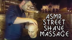 street barber head shave in venice with massage during storm