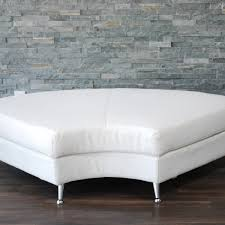 white leather curved bench one piece only platinum event rentals