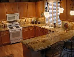 granite countertop midnight blue kitchen cabinets beveled tile