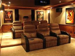 home theater with wall posters and velvet seats proper home