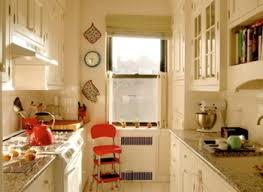 kitchen like a boat galley wood floor wood cabinet wood ceiling