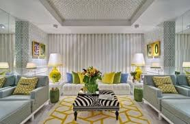 grey yellow green living room introduce mustard in rug and with scatter cushions living room