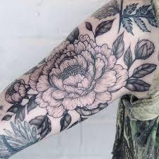 black and grey peony flower on right half sleeve tattoos