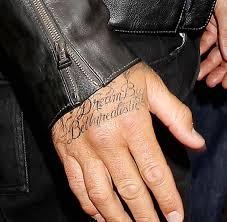 david beckham shows off new hand tattoo of jay z u0027s lyrics
