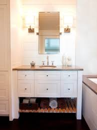 white and blue bathroom with sloped beadboard trim ceiling