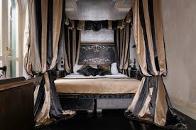 Small Bedroom King Bed A King Bed With Striped Taffeta Curtains Bishop Sleeved Up At The