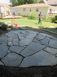 round patio stone how to install a flagstone patio with irregular stones diy