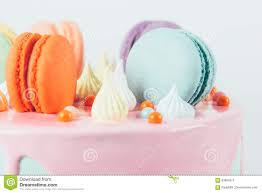 colorful macaron birthday cake and candy topping stock photo