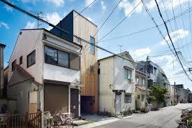 japanese skinny house reaches skyward curbed