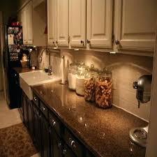 under upper cabinet lighting top of cabinet lighting white upper cabinets dark lower cabinets
