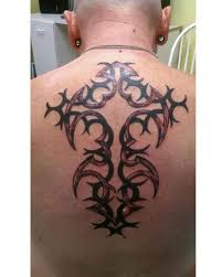 beautiful tribal cross on back