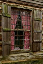 Curtains For A Cabin Log Cabin Window With Old Fashioned Shutters And Red And White