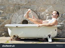 royalty free man in the outdoor bathtub washes his u2026 285910532