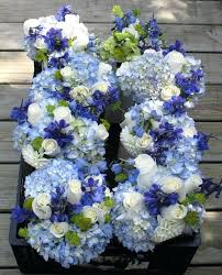 wedding flowers blue blue yellow and white flower arrangements blue wedding flower