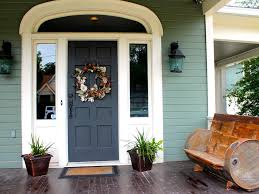 blue green siding and dark green front door cottage exterior