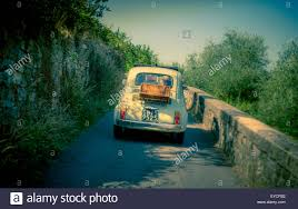 driving italy fiat 500 cars driving on a road in florence italy
