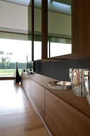 unico modern wall storage system in walnut wood and green glass