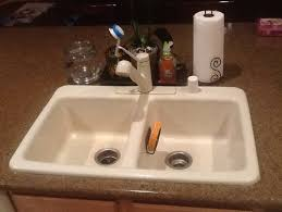 choosing a kitchen sinkage faucet to match bisque appliances