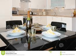 dining table in modern open plan apartment royalty free stock