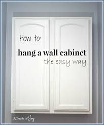 Installing Wall Cabinets In Laundry Room How To Hang A Wall Cabinet The Easy Way A Pinch Of Great