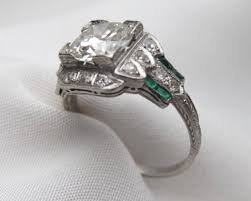 deco engagement ring deco diamond and baguette cut emerald engagement ring