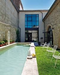 narrow swimming pool with modern home design in france also white