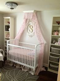 pink and gray nursery with crib canopy for baby nursery